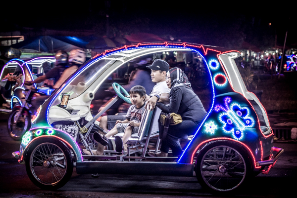 Pedal-power cars for night fun.