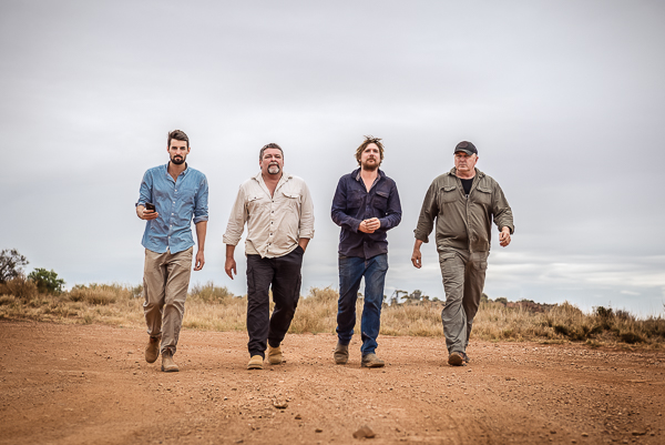 The Dirt Dogs walking down a dirt road